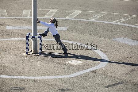 senior woman doing pilates exercise on