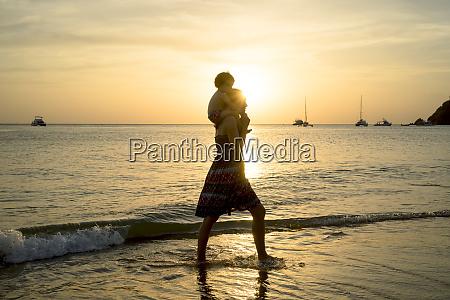 thailand koh lanta silhouette of mother