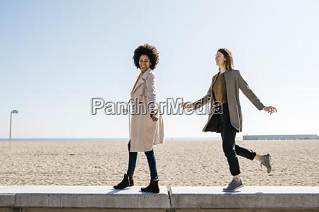 two happy friends walking on the