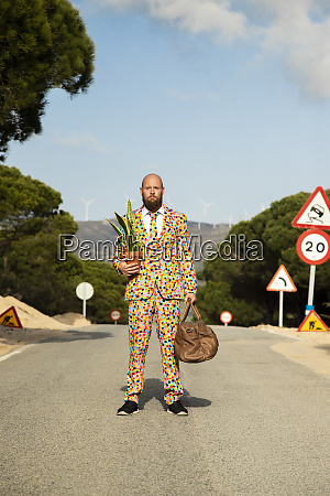 man wearing suit with colourful polka