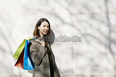 portrait, of, smiling, woman, with, shopping - 26917005