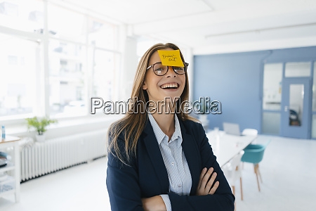 young businesswman with yellow sticky note