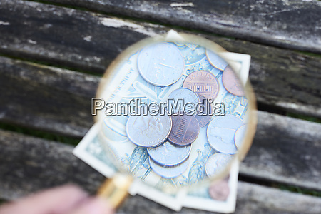 money under magnifying glass