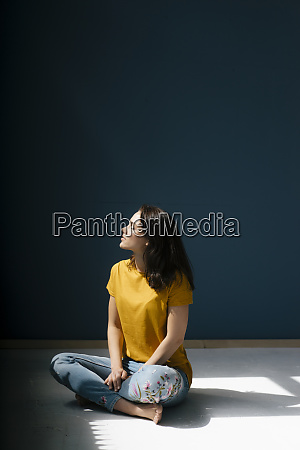 woman sitting cross legged in sunlight