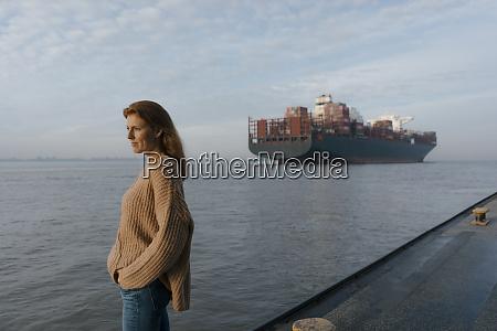 germany hamburg woman standing on pier