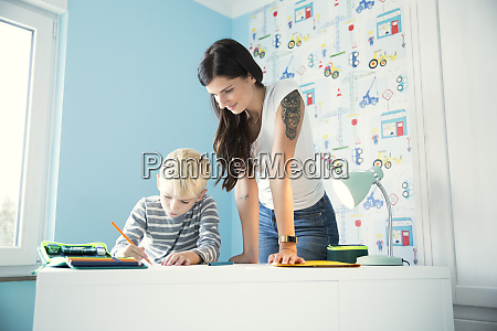 mother, helping, son, doing, homework, at - 26920631