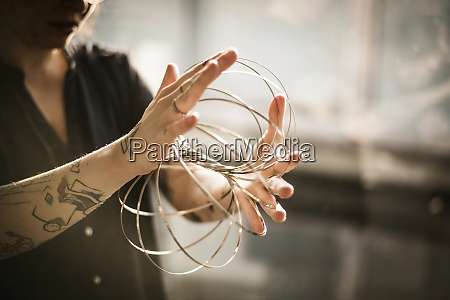 designer playing with ring forms