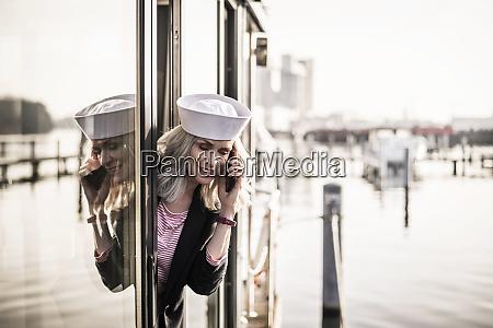 businesswoman wearing sailor hat working on