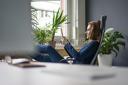 mature businesswoman working in sustainable office