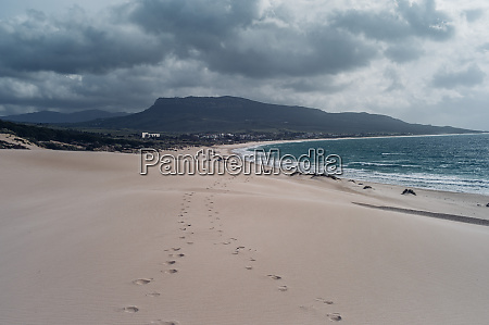 spain tarifa beach with footmarks in