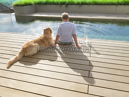 senior woman sitting with dog at