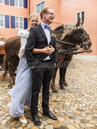 happy bride and groom on cobblestone