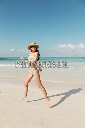 spain mallorca happy young woman on
