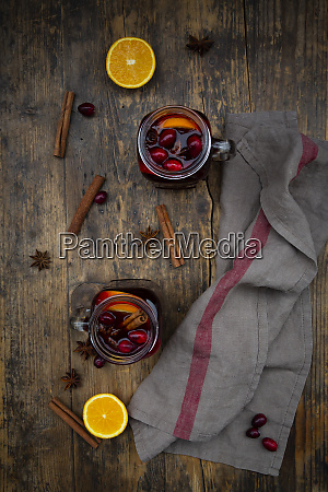 glasses of mulled wine with cranberries