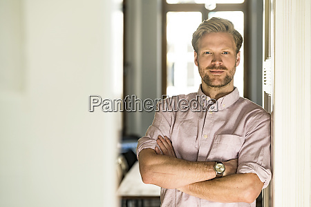 portrait of confident casual man leaning