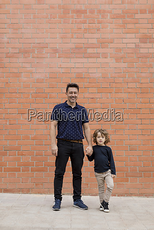 portrait of father and son standing