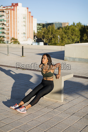 young woman doing workout exercise in