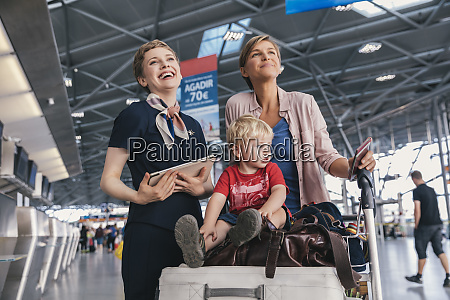 happy airline employee with mother and