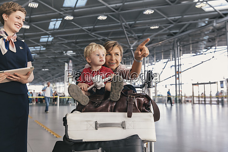travelling mother showing her young child