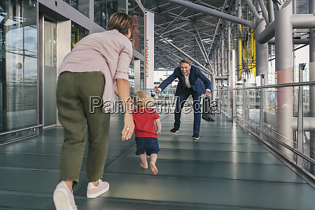 happy child running into arms of