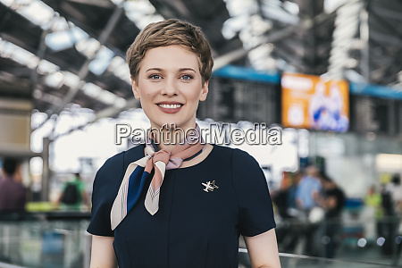 portrait of smiling airline employee at