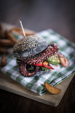 black burger with fried octopus and