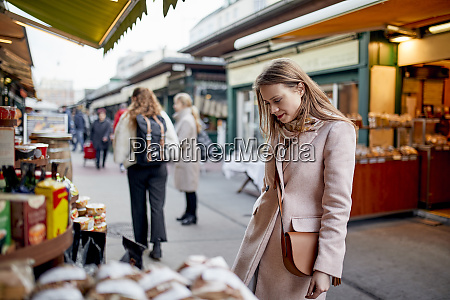 austria vienna woman looking at offer