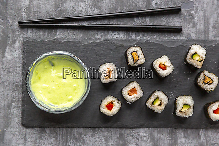 sushi on slabe plate wasabi in