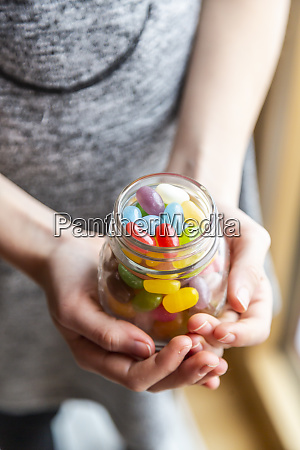 glass of colourful sweet jellybeans on