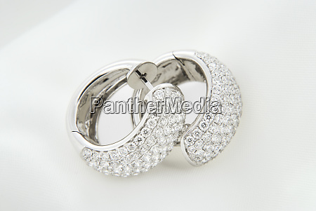 white gold earrings with diamonds on