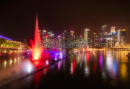 singapore cityscape at night trick fountains