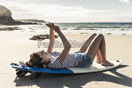 young woman on the beach relaxing