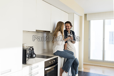 affectionate couple drinking redwine in the