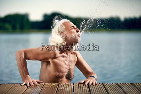 senior man with white hair leaning