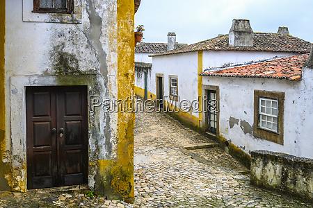 weathered building exteriors obidos leiria district
