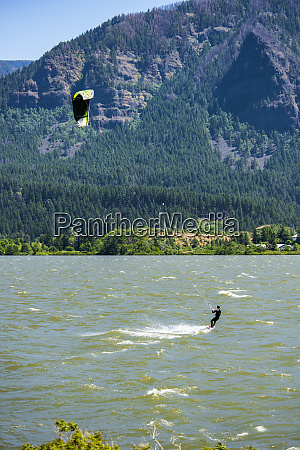 a kite surfer enjoying the strong