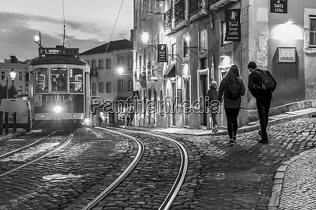 street car and pedestrians at dusk