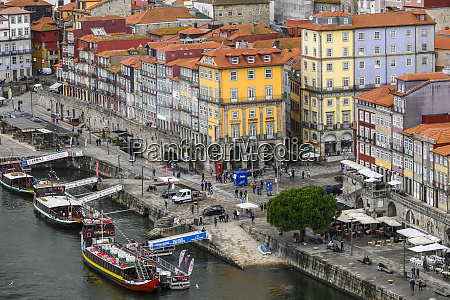 colourful buildings and boats moored in