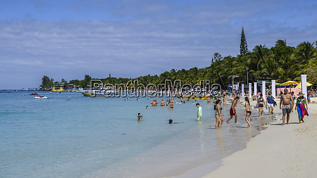 tourists at west bay beach roatan