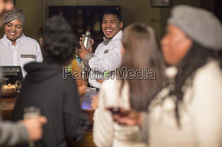 happy, bartender, making, drinks, in, a - 26932082