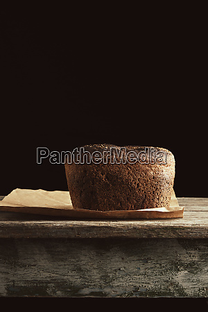 baked rye bread lies flour on