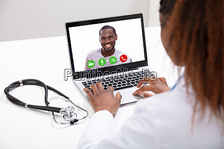 doctor video conferencing with male colleague