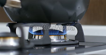 stove top burner igniting into a