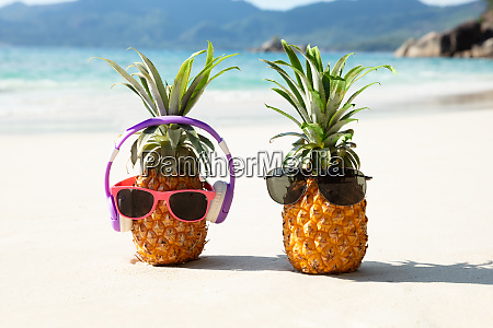 pineapple with headphone and sunglasses on