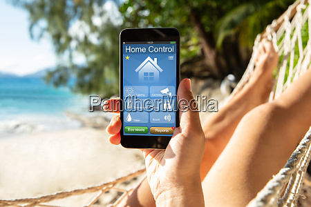 woman using smart home on mobile