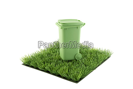 green recycle bin on square of