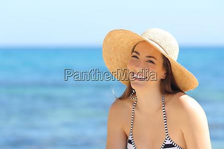 beautiful sunbather posing on the beach