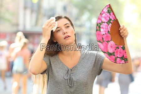 girl complaining suffering heat stroke