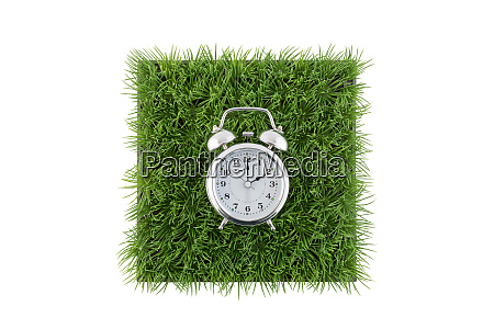 old style alarm clock on square