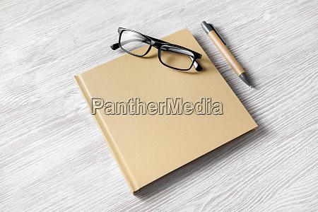 square book glasses pen
